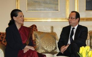 Chief of India's ruling Congress party Gandhi smiles as she speaks with France's President Hollande during their meeting in New Delhi