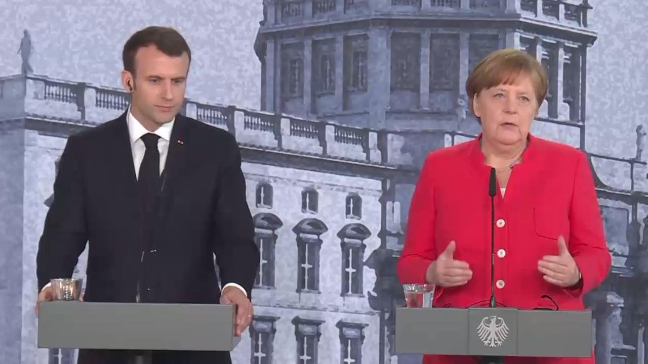 Merkel y Macron piden compromiso para reformar la zona euro