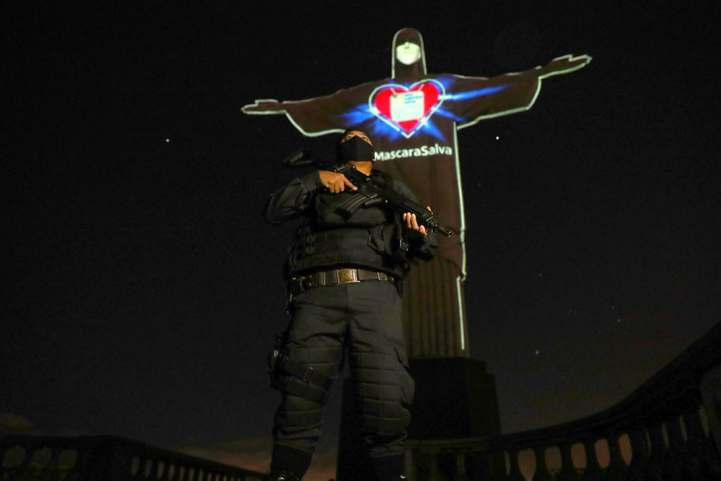 Statue of Christ the Redeemer lit up with face mask to promote self care following coronavirus disease (COVID-19) outbreak, in Rio de Janeiro