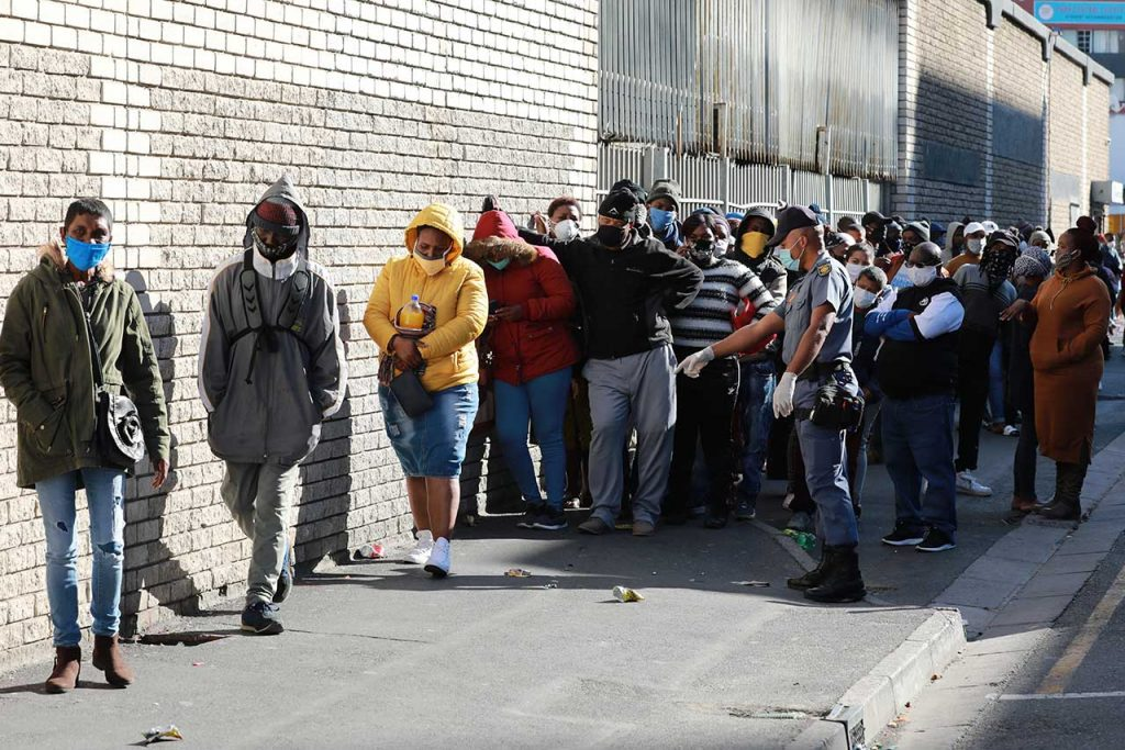 CORONAVIRUS South Africans queue at the Department of Labour in Cape Town to claim for UIF