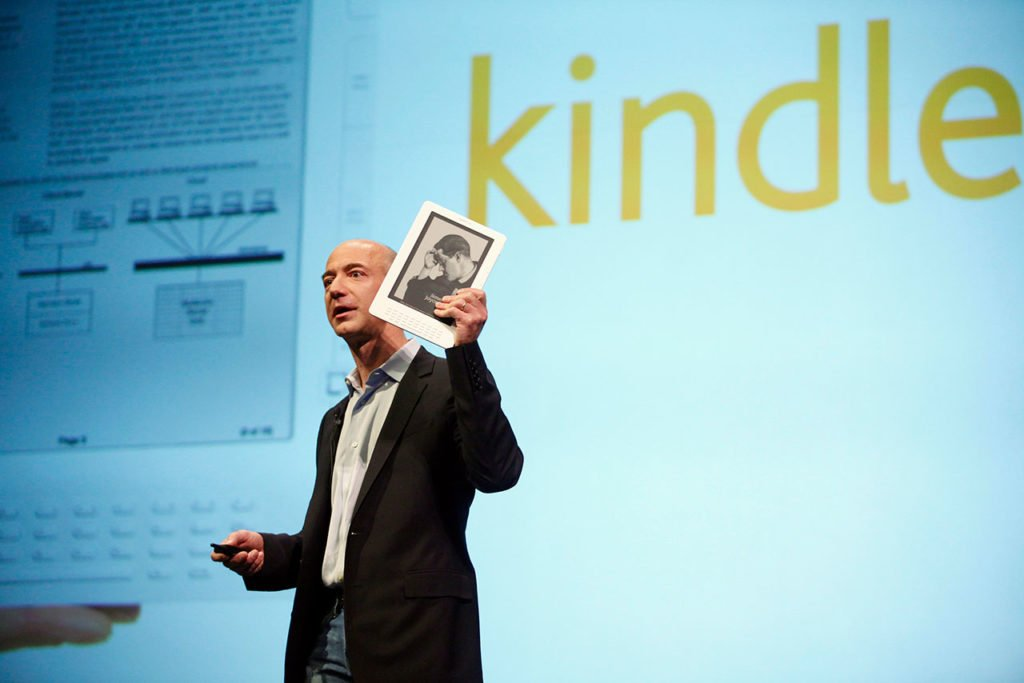 Amazon.com founder and CEO Jeff Bezos holds the new Kindle DX electronic reader