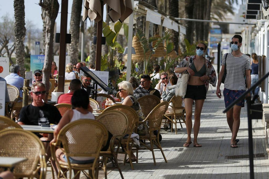 España Covid-19 People take a drink or chill in a terrace bar at Playa de Palma beach in Palma de Mallorca