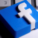Facebook logo is seen placed on a keyboard in this illustration