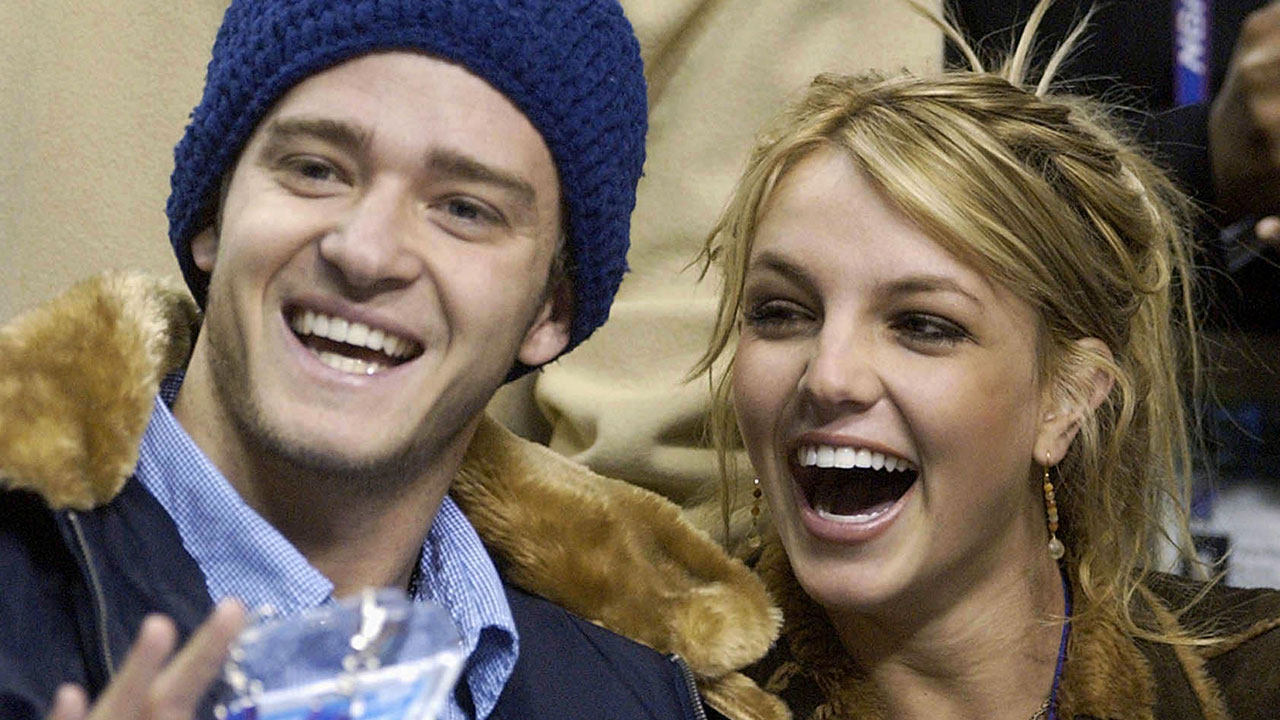 """Britney Spears and boyfriend singer Justin Timberlake of the group """"N'Sync"""" laugh moments"""