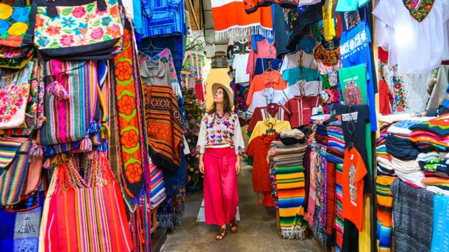 Vestido tradicional Mexicano Woman walking in a colorful market, Guanajuato city, Mexico