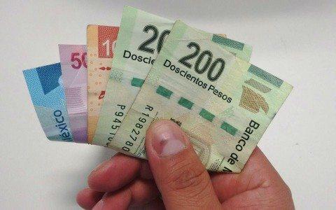 Moneda y bolsa recortan pérdidas; dólar se vende en 21.05 pesos